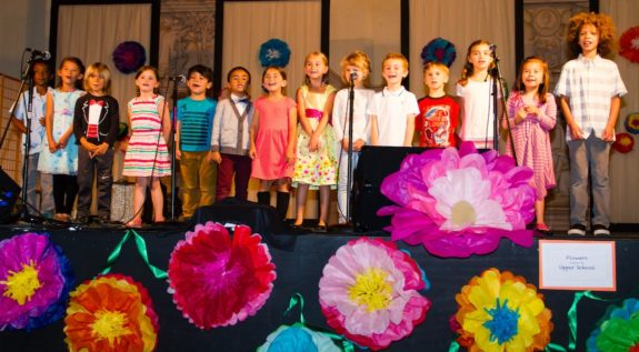 Lower School Students Singing on Stage at Spring Into The Arts 2016