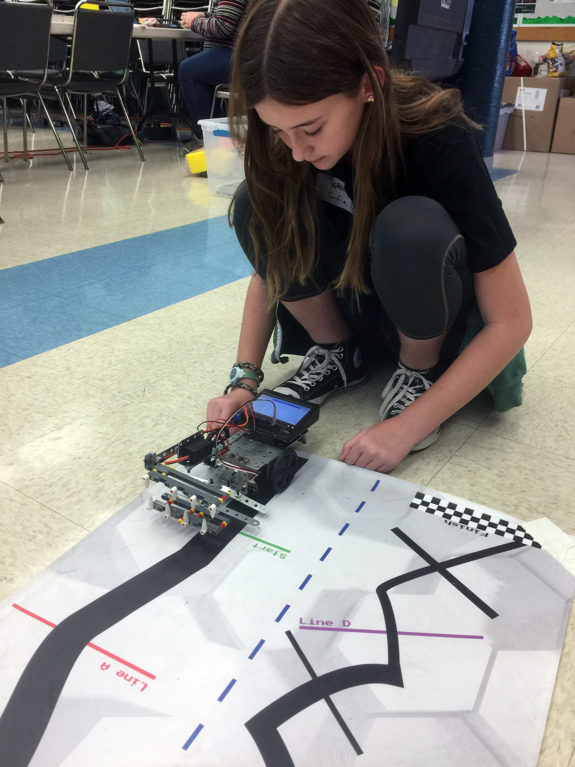 Middle School Student Testing Robot at Garden Street Academy Robotics Team Botball Workshop