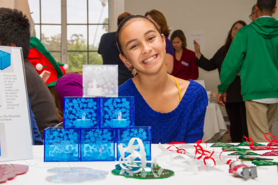 Eighth Grade Student Selling Acrylic Candle Holders and Ornaments