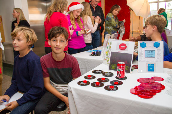 Eighth Grade Students Selling 3D Printed Rings and Acrylic Coasters