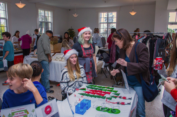 Eighth Grade Entrepreneur Students Selling 3D-Printed Nutcrackers and Acrylic Christmas Tree Ornaments