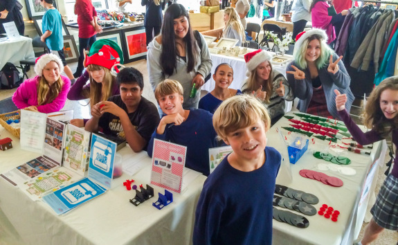 Eighth Grade Entrepreneur Students at Holiday Boutique Table