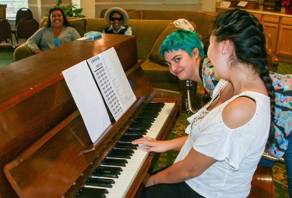 Garden Street Academy Jazz Band Members Play Piano at Garden Court Retirement Community