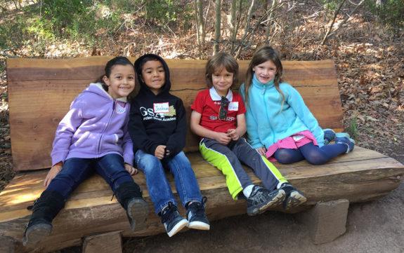Garden Street Academy K-1 Field Trip Santa Barbara Botanic Garden Students - Sitting on Tree Bench