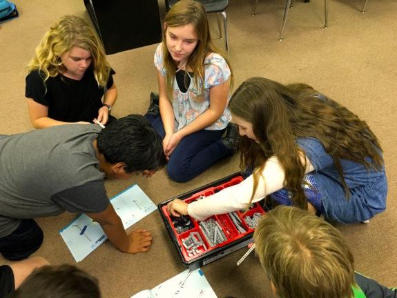 Garden Street Academy 6th Grader Assembling Lego Wind Turbines