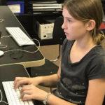 Elementary student writing code at Garden Street Academy