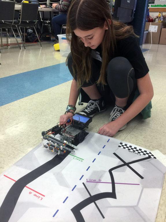 Middle School Student Testing Robot at Garden Street Academy Robotics Team Botball Workshop