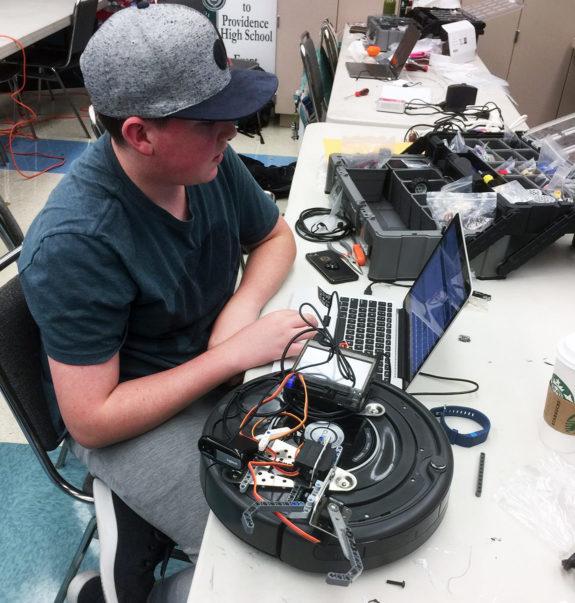 High School Student Programming Robot at Garden Street Academy Robotics Team Botball Workshop